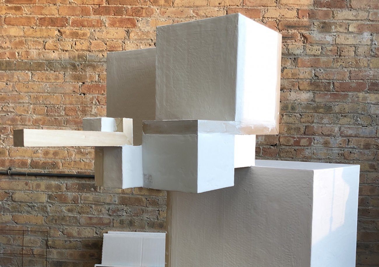Image of a geometric sculpture in the artists studio.
