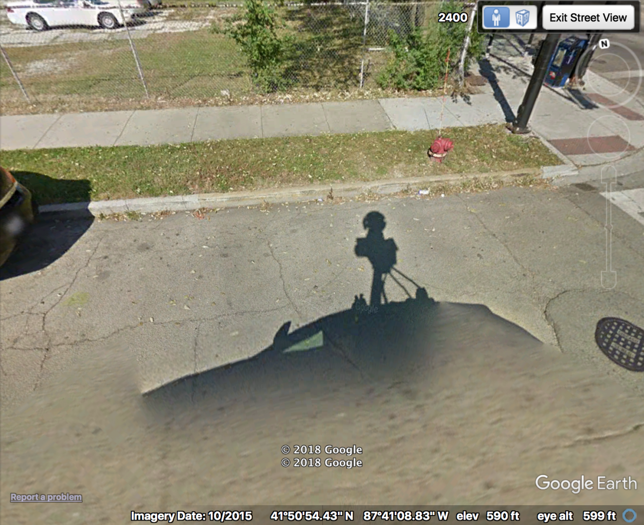 Image of a google satellite image showing the google maps car's shadow in the foreground.