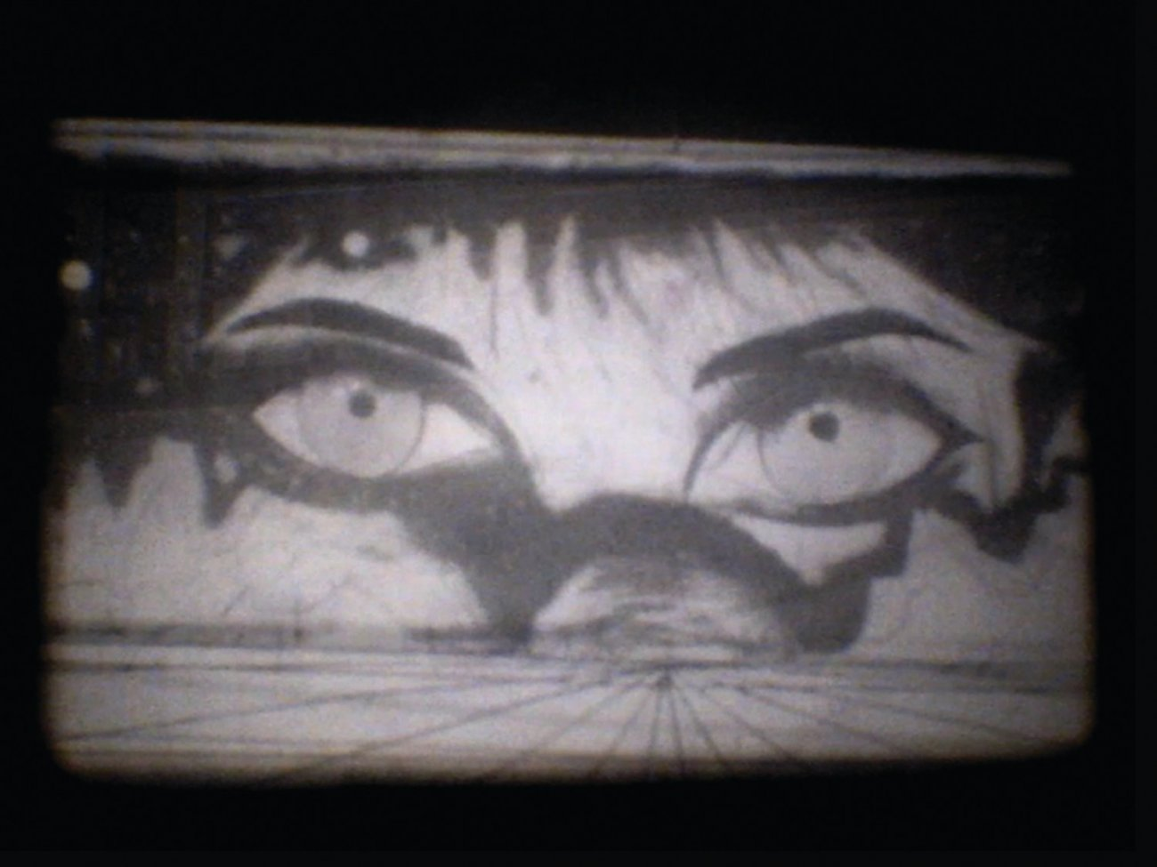 Black and white film still showing animated eyes