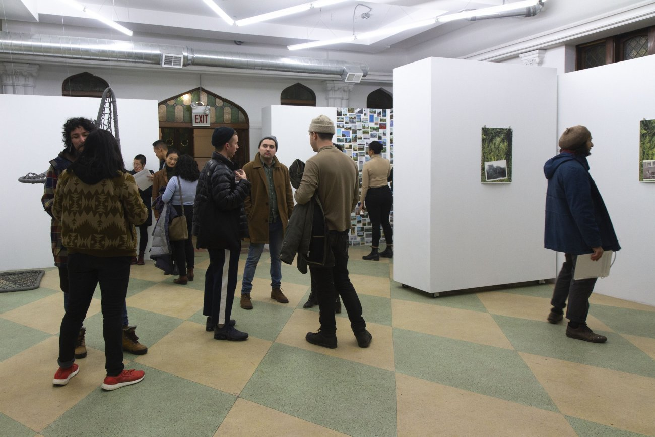 People gather in gallery at opening reception